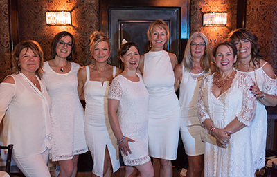 Women in White: Elegant Evening Benefits Children's Wish Foundation - Image 5